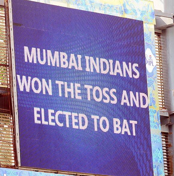 A shot on the giant screen reflects the toss result