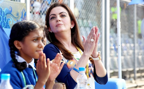 Nita Ambani (right)
