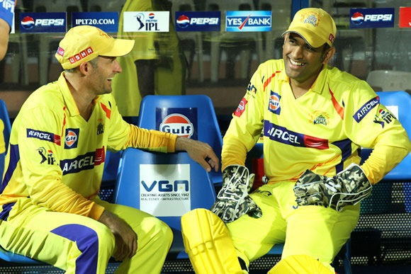 CSK's Mike Hussey with MS Dhoni (right)