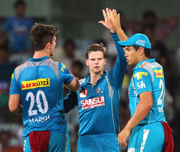 Mitchell Marsh (left) celebrates the wicket of S Badrinath with team mates Steven Smith and Ross Taylor (right)