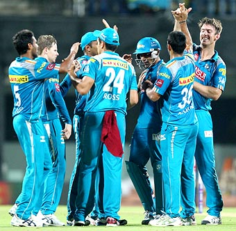 Pune Warriors celebrate the fall of a Chennai wicket