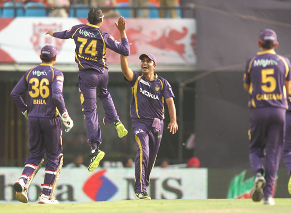 Kolkata Knight Riders player Sunil Narine is congratulated by teammates after his hat-trick
