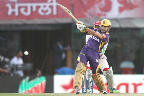 Kolkata Knight Riders captain Gautam Gambhir pulls a delivery to the boundary