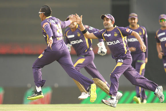 Sunil Narine of Kolkata Knight Riders celebrates with Kolkata Knight Riders captain Gautam Gambhir after bowling Gurkeerat Mann Singh of Kings XI Punjab to get his hatrick