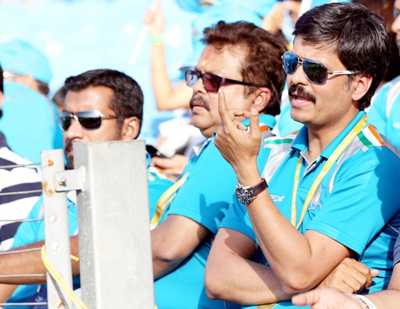 Abhijit Sarkar, director, and Sushanto Roy, owner of Pune Warriors, watch the match from the stands