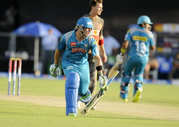 Aaron Finch of Pune Warriors drops his bat as he tries to complete a run