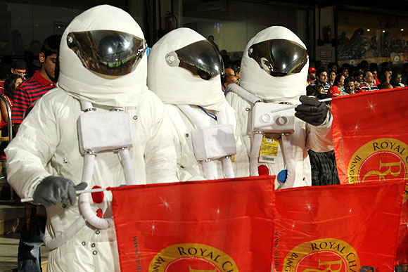 RCB fans in cool astronaut gear