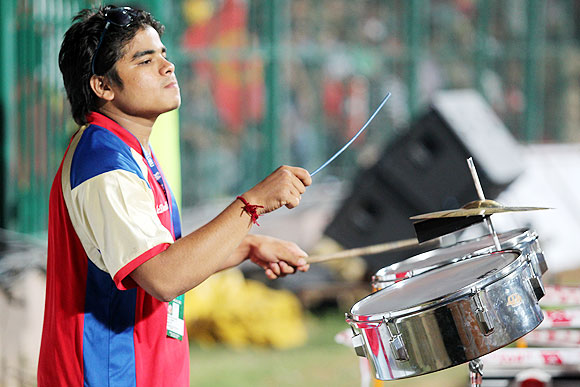 A drummer, supporting RCB, goes on with his job on Tuesday
