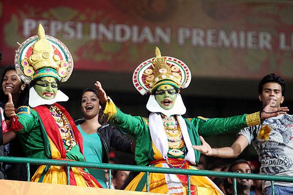 Fans dressed a Indian classical dancers in the stands