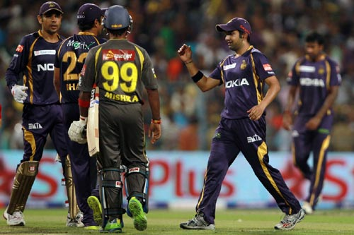 Kolkata Knight Riders team celebrate after winning a game