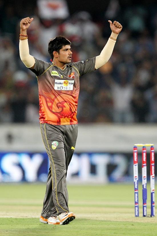 Karan Sharma celebrates after dismissing Adam Gilchrist