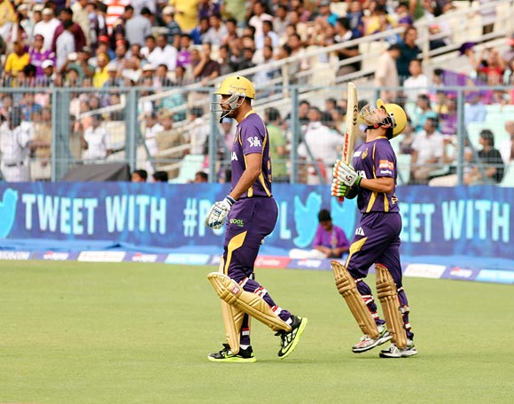 Yusuf Pathan (left) walks out to open the batting with Gautam Gambhir