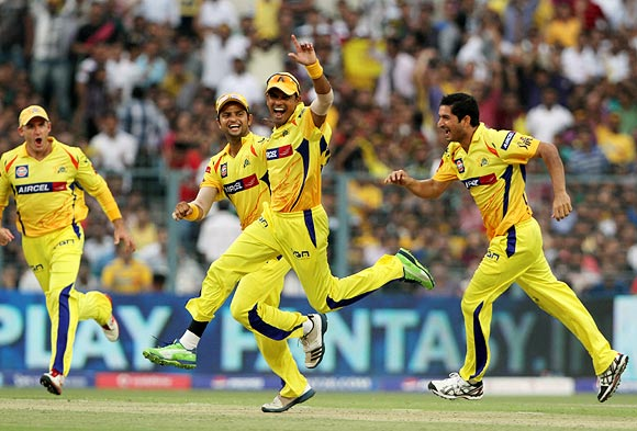 S Badrinath (centre) celebrates with team mates after running out Jacques Kallis