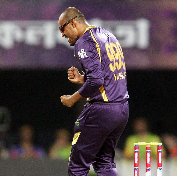 Yusuf Pathan celebrates getting the wicket of Suresh Raina