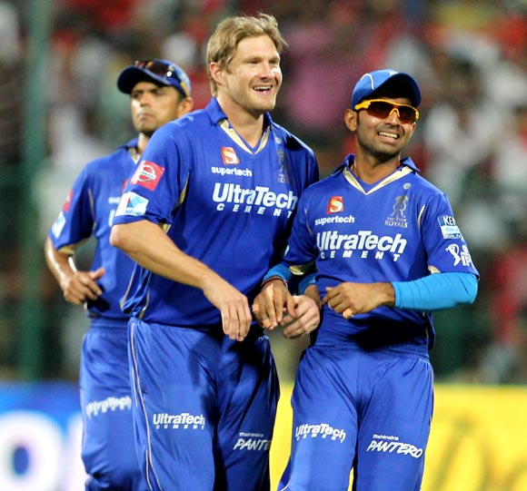 Shane Watson (left) and Ajinkya Rahane celebrate the wicket of Tillakaratne Dilshan