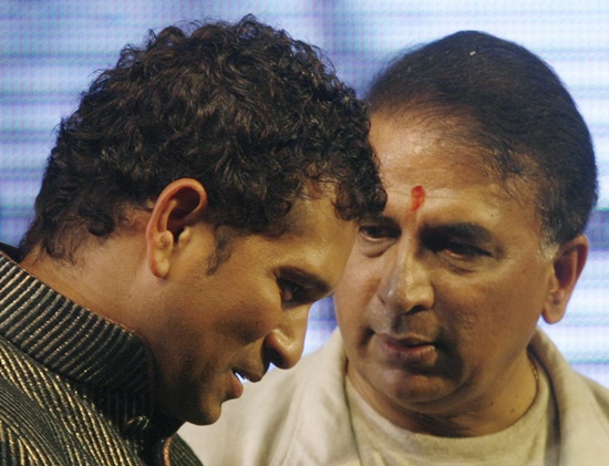 Sachin Tendulkar (left) listens to former cricketer Sunil Gavaskar