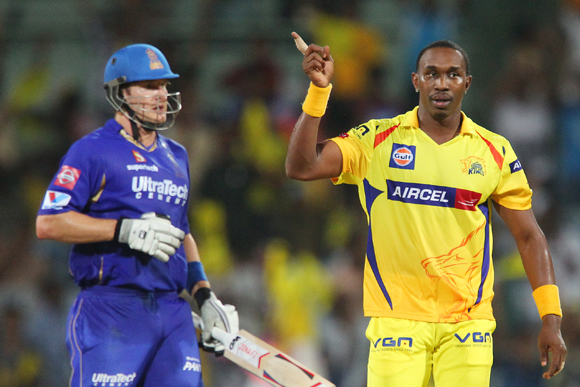 Dwayne Bravo celebrates the wicket of Shane Watson