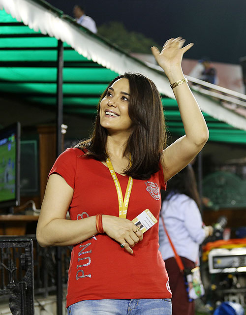 Preity Zinta waves to the crowd during the match between Kings XI Punjab and Pune Warriors India on Sunday