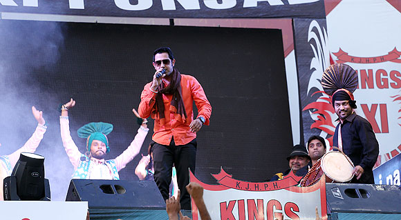 A singer performs before the match between The Kings XI Punjab and the Pune Warriors in Mohali on Sunday