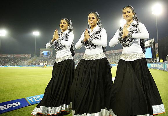 Cheergirls pose before the match between The Kings XI Punjab and the Pune Warriors in Mohali on Sunday
