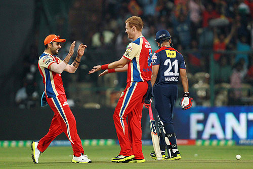 RCB's Virat Kohli celebrates with a teammate