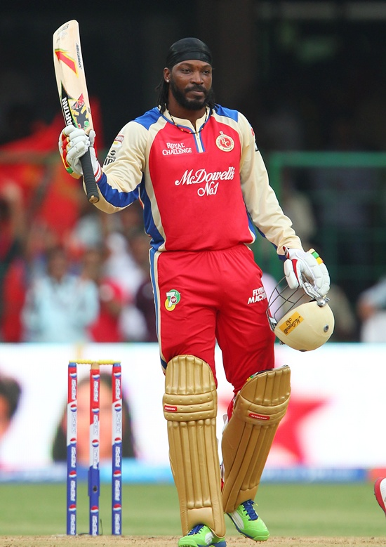 Chris Gayle celebrates after gettting to fifty