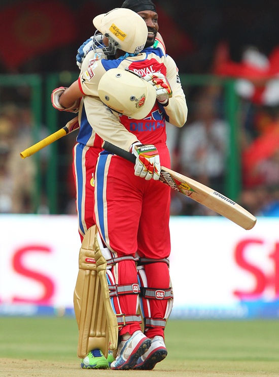 Chris Gayle celebrates with Tillakaratne Dilshan after getting to 150