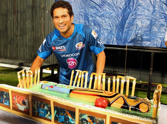 Sachin Tendulkar cuts his birthday cake at the Eden Gardens in Kolkata