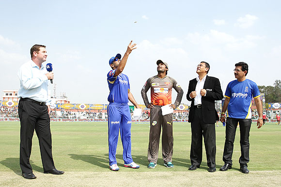 Rajasthan Royals captain Rahul Dravid tosses the coin as Sunrisers Hyderabad capt