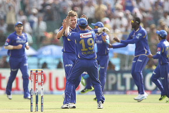 James Faulkner of Rajasthan Royals is congratulated by Rajasthan Royals captain Rahul Dravid on claiming a wicket