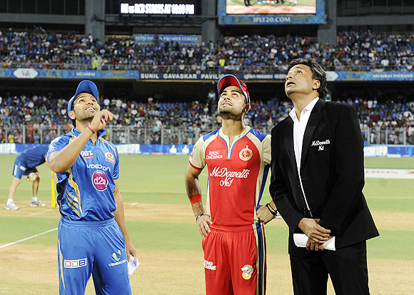 Rohit Sharma spins the coin as Virat Kohli looks on during the toss on Saturday