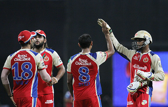 RCB players celebrate Rohit Sharma's dismissal