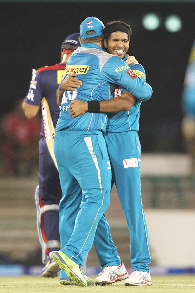 Ashok Dinda celebrates the wicket of Virender Sehwag