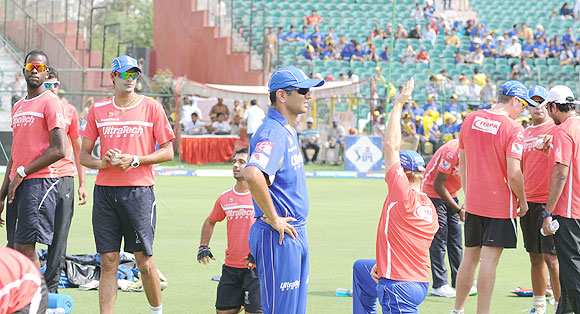 Rajasthan Royals' players at a training session as captain Rahul Dravid looks on