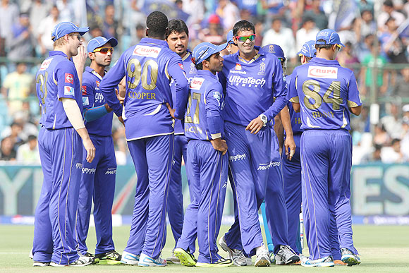 Off-spinner Ajit Chandila (second from right) celebrates a wicket with teammates