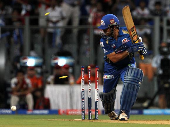 Mumbai Indian player Sachin Tendulkar gets bowled