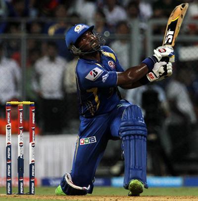 Mumbai Indian player Dwayne Smith plays a shot