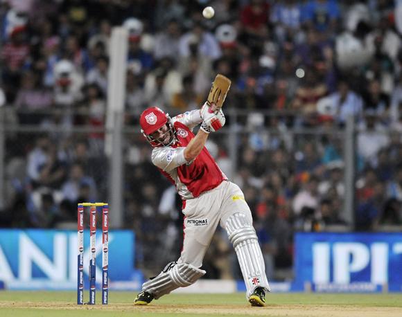 Kings XI Punjab player David Hussey plays a shot