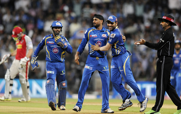Harbhajan Singh and Rohit Sharma celebrate the fall of Gurkeerat Mann's wicket