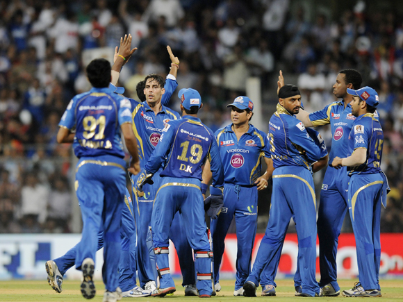Mitchell Johnson of Mumbai Indians celebrates the wicket of Manan Vohra of Kings XI Punjab