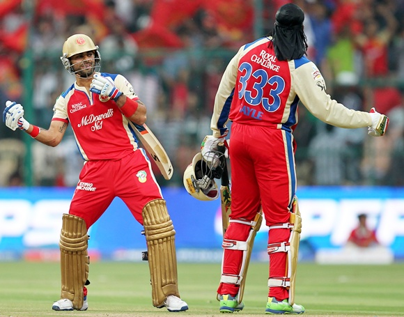 Virat Kohli with Chris Gayle
