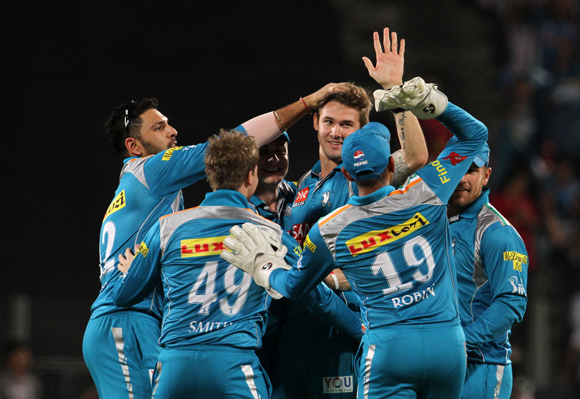 Pune Warriors player Kane Richardson celebrates with his teammates