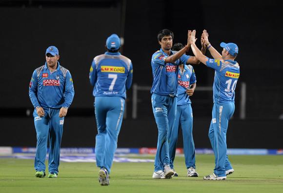 Rahul Sharma of Pune Warriors celebrates the wicket of Wriddhiman Saha of Chennai Super Kings
