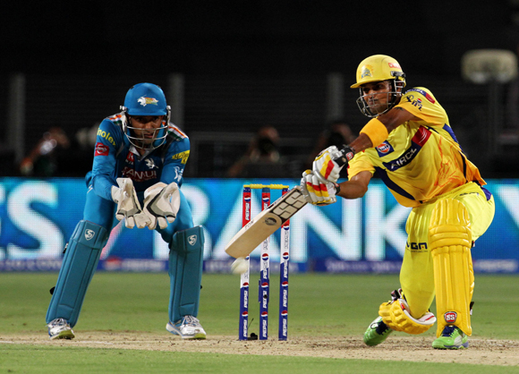 Chennai Super King player Subramaniam Badrinath plays a shot