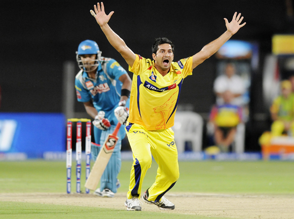 Chennai Super King player Mohit Sharma celebrates after getting the wicket of Pune Warriors player Aaron Finch