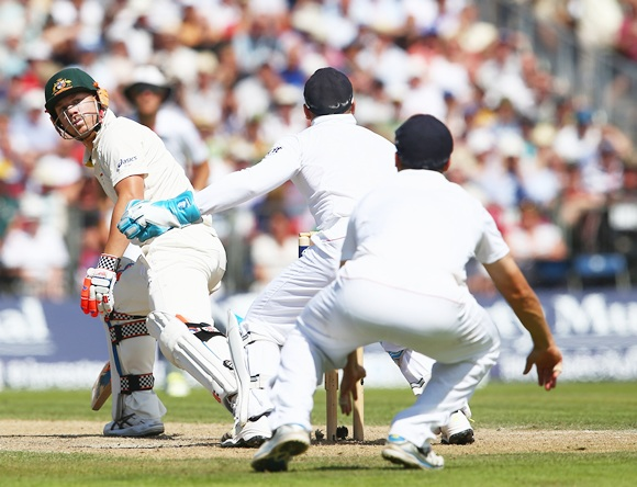 David Warner of Australia looks back as wicketkeeper Matt Prior of England juggles a catch to Jonathan Trott leading to his dismissal