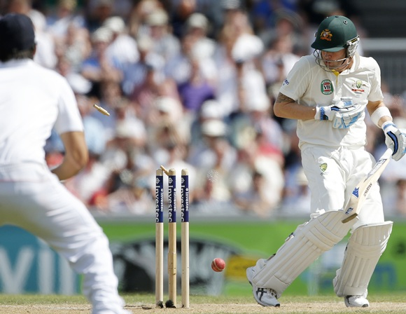 Australia's Michael Clarke reacts after being bowled by England's Stuart Broad
