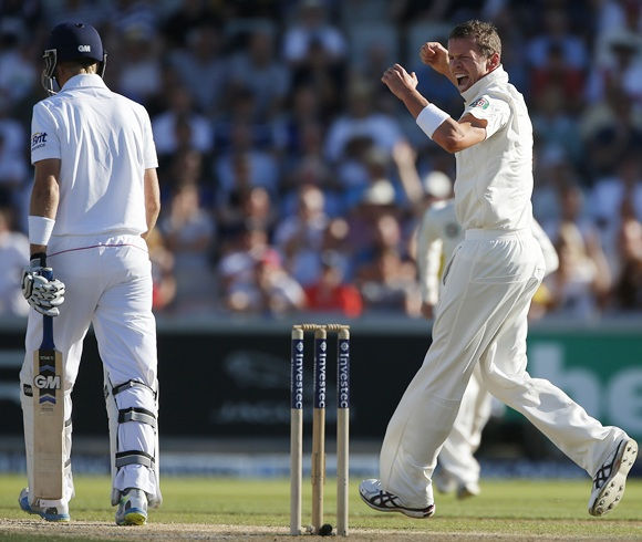 Australia's Peter Siddle (right) celebrates after dismissing England's Joe Root