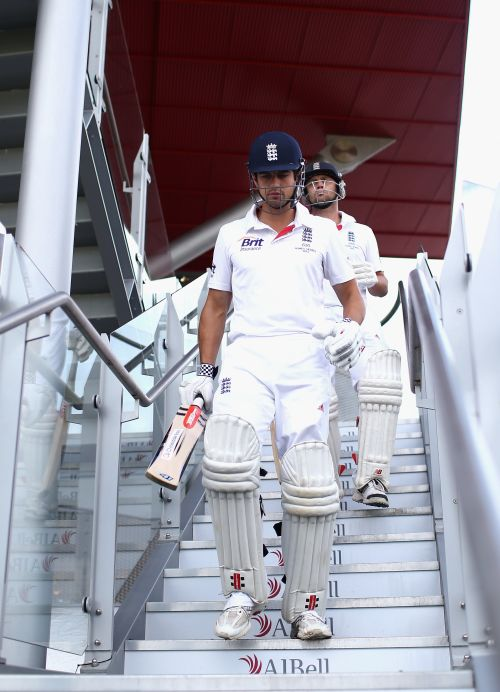Alastair Cook and Jonathan Trott of England walk out to bat during day three of the 3rd Ashes Test