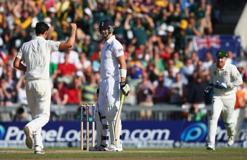 Kevin Pietersen (C) of England is trapped lbw for 113 off the bowling of Mitchell Starc (L) of Australia